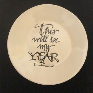 Small decorative plate measures 6 inches round.